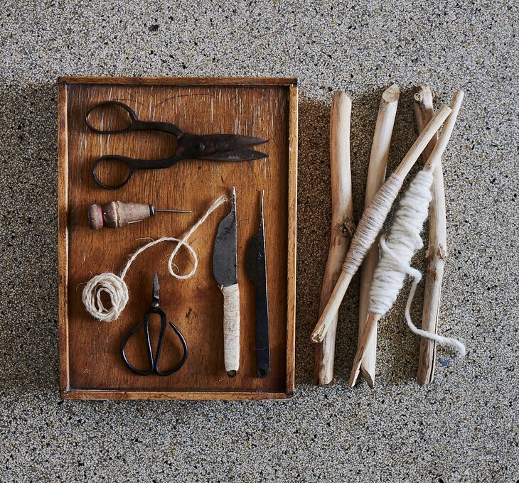 Background picture with old tools and yarn to services